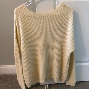 Long sleeve beige sweater with tie up back